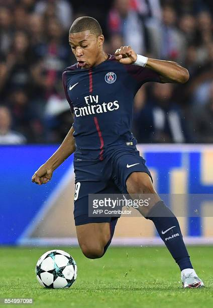 Paris SaintGermain's French forward Kylian Mbappe controls the ball during the UEFA Champions League football match between Paris SaintGermain and...