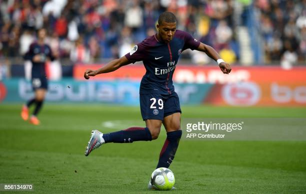 Paris SaintGermain's French forward Kylian Mbappe controls the ball during the French Ligue 1 football match between Paris SaintGermain and Bordeaux...