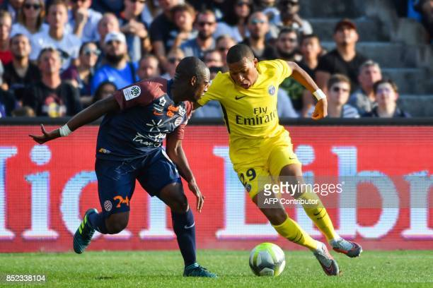 Paris SaintGermain's French forward Kylian Mbappe dribbles Montpellier's French defender Jérôme Roussillon during the French Ligue 1 football match...