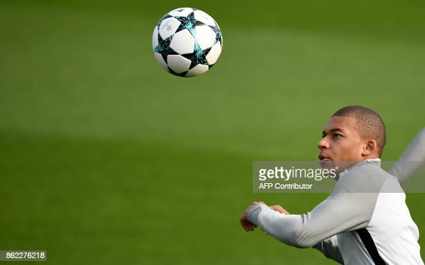 Paris SaintGermain's French forward Kylian Mbappe eyes the ball during a training session on October 17 2017 in SaintGermainenLaye western Paris on...