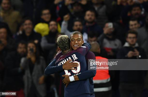 TOPSHOT Paris SaintGermain's French forward Kylian Mbappe is congratuled by Paris SaintGermain's Brazilian forward Neymar after scoring a goal during...