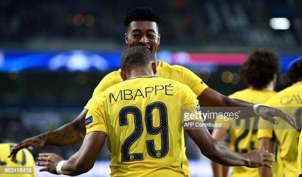 Paris SaintGermain's French forward Kylian M'Bappe is congratuled by Paris SaintGermain's French defender Presnel Kimpembe after scoring a goal...
