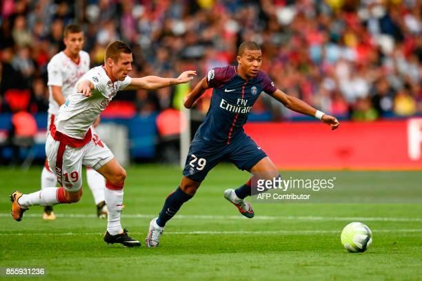 Paris SaintGermain's French forward Kylian Mbappe outruns Bordeaux's Danish midfielder Lukas Lerager during the French L1 football match Paris...