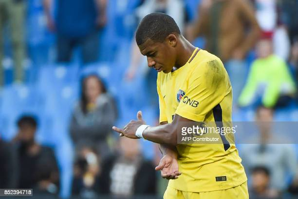 Paris SaintGermain's French forward Kylian Mbappe reacts after the French Ligue 1 football match between Paris SaintGermain and Montpellier on...