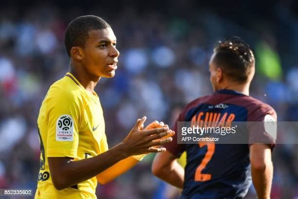 Paris SaintGermain's French forward Kylian Mbappe reacts during the French Ligue 1 football match between Paris SaintGermain and Montpellier on...