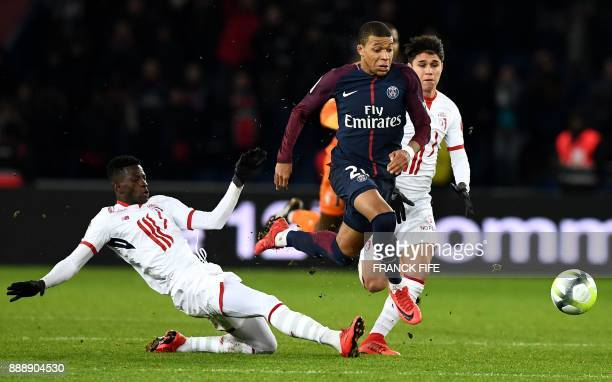 Paris SaintGermain's French forward Kylian MBappe runs on his way to score a last second goal during the French L1 football match between Paris...