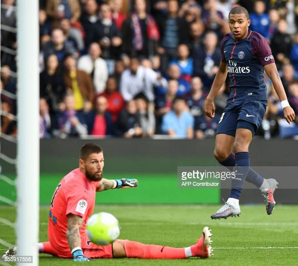 Paris SaintGermain's French forward Kylian Mbappe scores his team's 6th goal past Bordeaux's French goalkeeper Benoit Costil during the French L1...