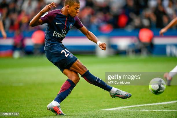 Paris SaintGermain's French forward Kylian Mbappe shoots to score his team's 6th goal during the French L1 football match Paris SaintGermain vs...