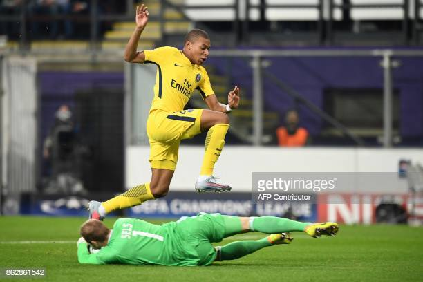 Paris SaintGermain's French forward Kylian Mbappe vies for the ball with with Anderlecht's Belgian goalkeeper Matz Sels during the UEFA Champions...