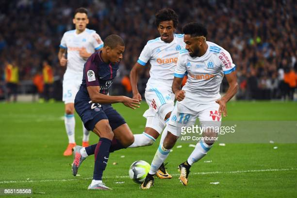 Paris SaintGermain's French forward Kylian Mbappe vies for the ball with Marseille's French defender Jordan Amavi and Marseille's Brazilian...