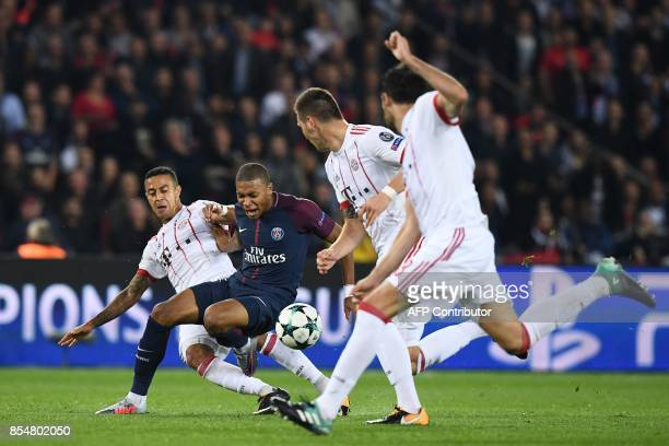 Paris SaintGermain's French forward Kylian Mbappe vies with Bayern Munich's Spanish midfielder Thiago Alcantara during the UEFA Champions League...