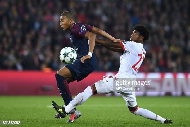 Paris SaintGermain's French forward Kylian Mbappe vies with Bayern Munich's Austrian defender David Alaba during the UEFA Champions League football...