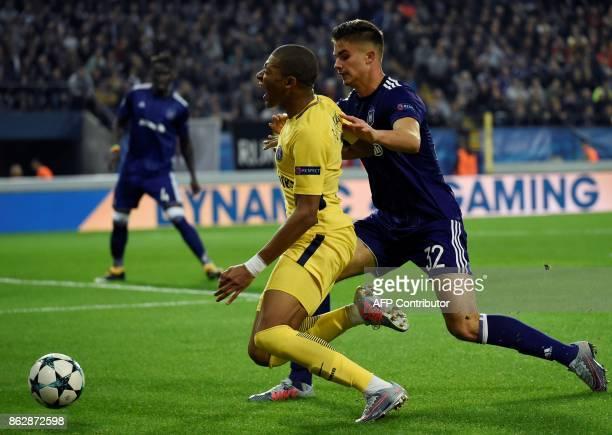 Paris SaintGermain's French forward Kylian Mbappe vies with Anderlecht's Belgian midfielder Leander Dendoncker during the UEFA Champions League Group...