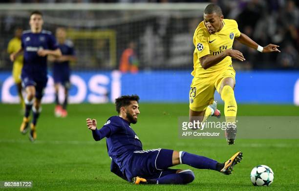 Paris SaintGermain's French forward Kylian Mbappe vies with Anderlecht's Portuguese defender Josue Sa during the UEFA Champions League Group B...