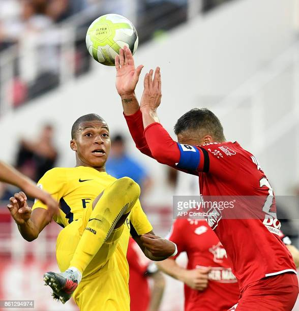 Paris SaintGermain's French forward Kylian M'Bappe vies with Dijon's French defender Cedric Varrault during the French L1 football match between...
