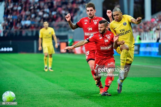 Paris SaintGermain's French forward Kylian Mbappe vies with Dijon's French midfielder Frederic Sammaritano during during the French L1 football match...