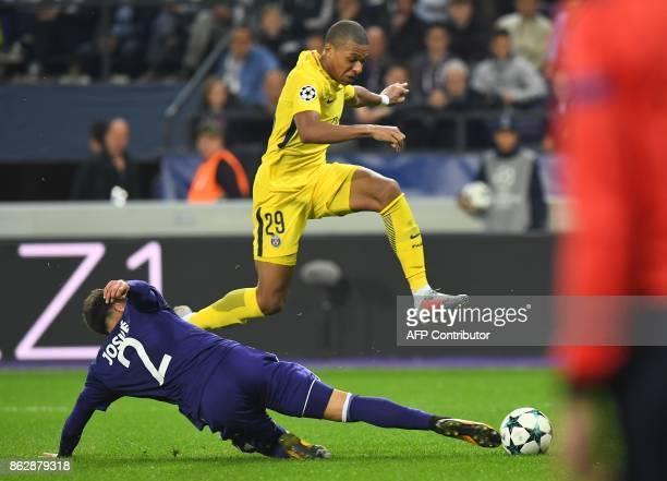 Paris SaintGermain's French forward Kylian Mbappe vies withAnderlecht's Portuguese defender Josue Sa during the UEFA Champions League Group B...