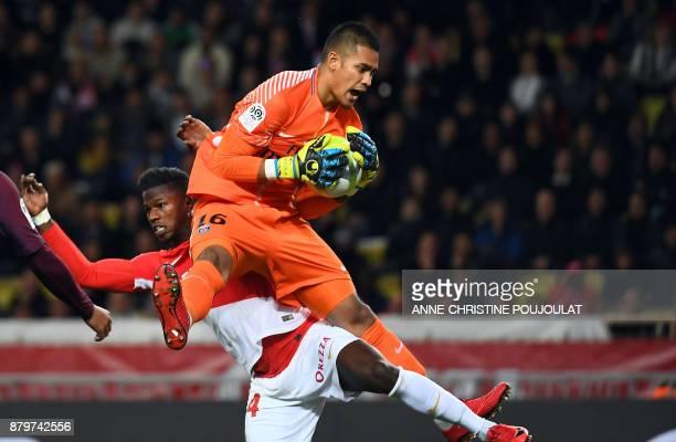 Paris SaintGermain's French goalkeeper Alphonse Areola catches the ball as he vies with Monaco's Senegalese forward Keita Balde Diao during the...