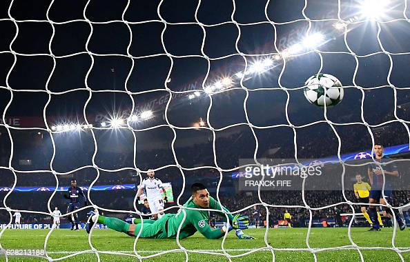 TOPSHOT Paris SaintGermain's French goalkeeper Alphonse Areola concedes a goal during the UEFA Champions League Group A football match between Paris...
