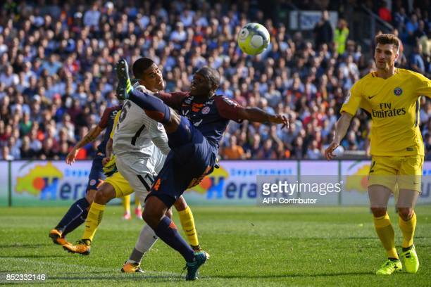 Paris SaintGermain's French goalkeeper Alphonse Areola deflects a shot under pressure from Montpellier's French defender Jérôme Roussillon as Paris...