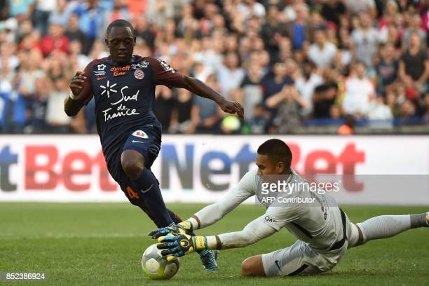 Paris SaintGermain's French goalkeeper Alphonse Areola dives to grab the ball in the feet of Montpellier's French defender Jérôme Roussillon during...