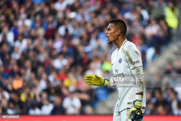 Paris SaintGermain's French goalkeeper Alphonse Areola reacts during the French Ligue 1 football match between Paris SaintGermain and Montpellier on...
