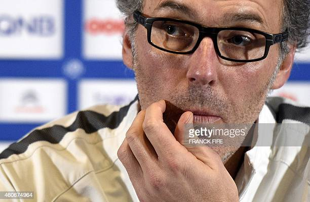 Paris SaintGermain's French head coach Laurent Blanc gives a press conference on December 19 2014 at the CampdesLoges in SaintGermainenLaye outside...