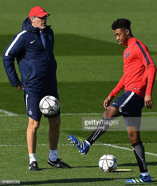 Paris SaintGermain's French head coach Laurent Blanc is pictured next to forward Christopher NKunku during a training session on April 5 2016 in...