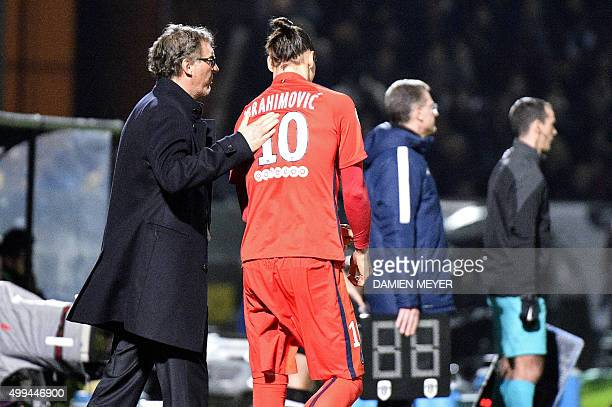 Paris SaintGermain's French head coach Laurent Blanc speaks with Paris SaintGermain's Swedish forward Zlatan Ibrahimovic as he prepares to enter in...