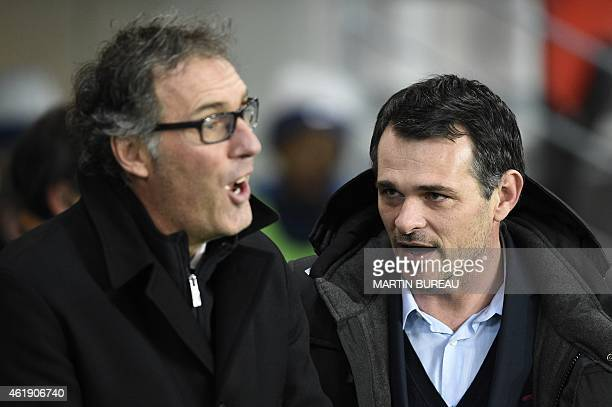 Paris SaintGermain's French head coach Laurent Blanc talks to Bordeaux' French head coach Willy Sagnol during the French Cup football match Paris...