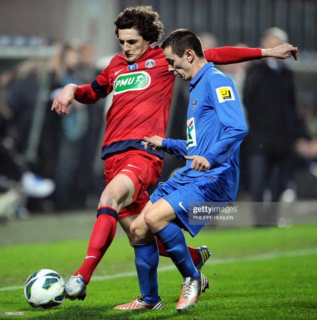 Paris Saint-Germain's French midfielde Rabiot Aorien (L) vies with Arras midfielder Bernard Sebastien during the French cup football match Arras vs Paris Saint-Germain, on January 6, 2013 at the Epopee Stadium in Calais, northern France.