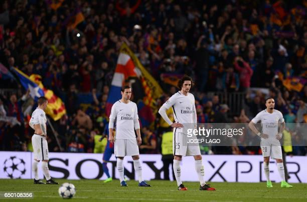Paris SaintGermain's French midfielder Adrien Rabiot and teammate stand on the pitch after Barcelona's midfielder Sergi Roberto scored his team's...