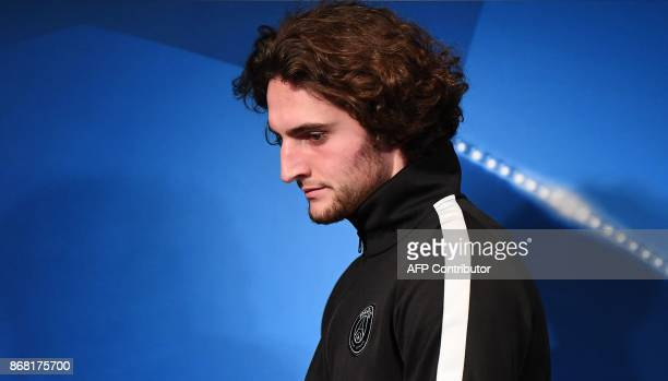 Paris SaintGermain's French midfielder Adrien Rabiot arrives for a press conference at the Parc des Princes stadium in Paris on October 30 2017 on...