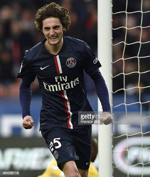Paris SaintGermain's French midfielder Adrien Rabiot celebrates after scoring his team's second goal during the French L1 football match between...
