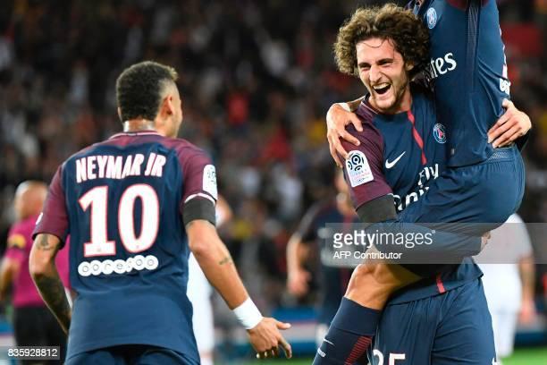 Paris SaintGermain's French midfielder Adrien Rabiot celebrates after scoring a goal with Paris SaintGermain's Brazilian forward Neymar during the...