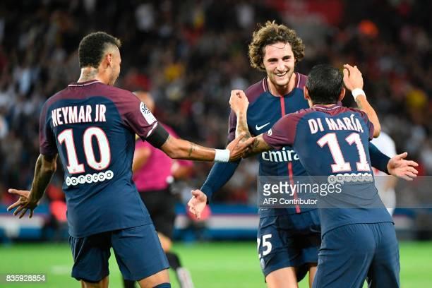 Paris SaintGermain's French midfielder Adrien Rabiot celebrates after scoring a goal with Paris SaintGermain's Brazilian forward Neymar and Paris...