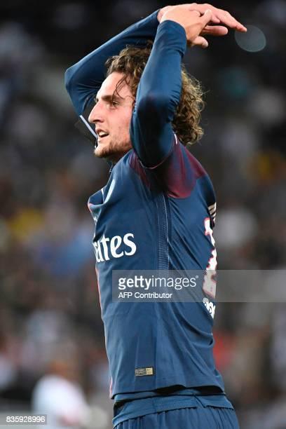 Paris SaintGermain's French midfielder Adrien Rabiot celebrates after scoring a goal during the French L1 football match Paris SaintGermain vs...