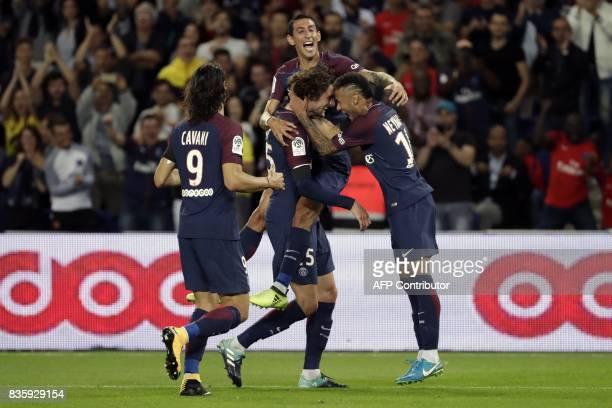 TOPSHOT Paris SaintGermain's French midfielder Adrien Rabiot celebrates after scoring a goal with Paris SaintGermain's Brazilian forward Neymar and...