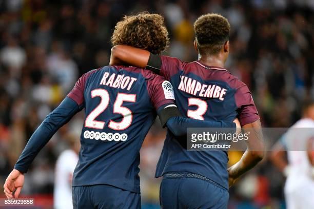 Paris SaintGermain's French midfielder Adrien Rabiot celebrates after scoring a goal with Paris SaintGermain's French defender Presnel Kimpembe...