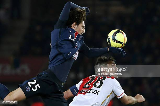 Paris SaintGermain's French midfielder Adrien Rabiot challenges Monaco's French midfielder Jeremy Toulalan during the French L1 football match...