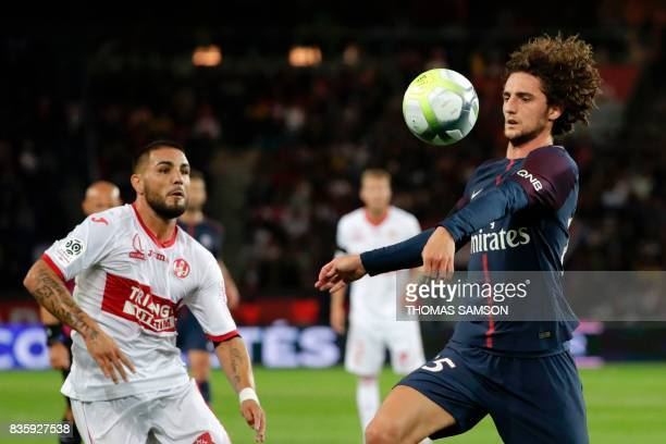 Paris SaintGermain's French midfielder Adrien Rabiot controls the ball next to Toulouse's French forward Andy Delort during the French L1 football...