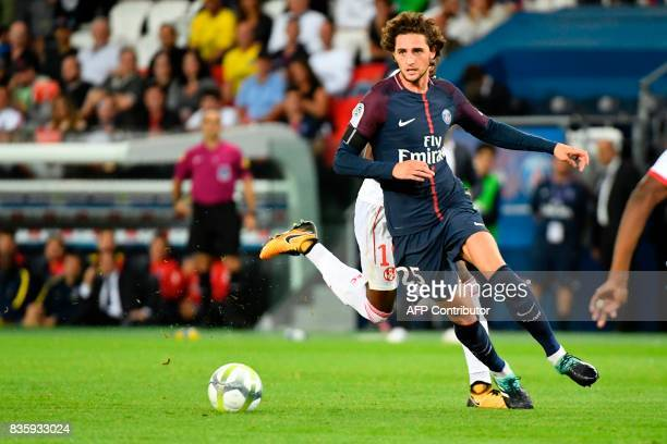 Paris SaintGermain's French midfielder Adrien Rabiot drives the ball during the French L1 football match Paris SaintGermain vs Toulouse FC at the...