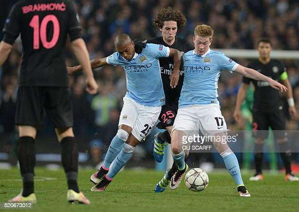 Paris SaintGermain's French midfielder Adrien Rabiot is blocked by Manchester City's Brazilian midfielder Fernandinho and Manchester City's Belgian...