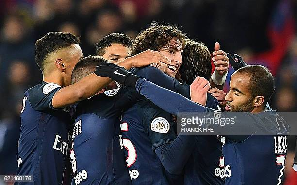 Paris SaintGermain's French midfielder Adrien Rabiot is congratulated by teammates after scoring a goal during the French L1 football match between...