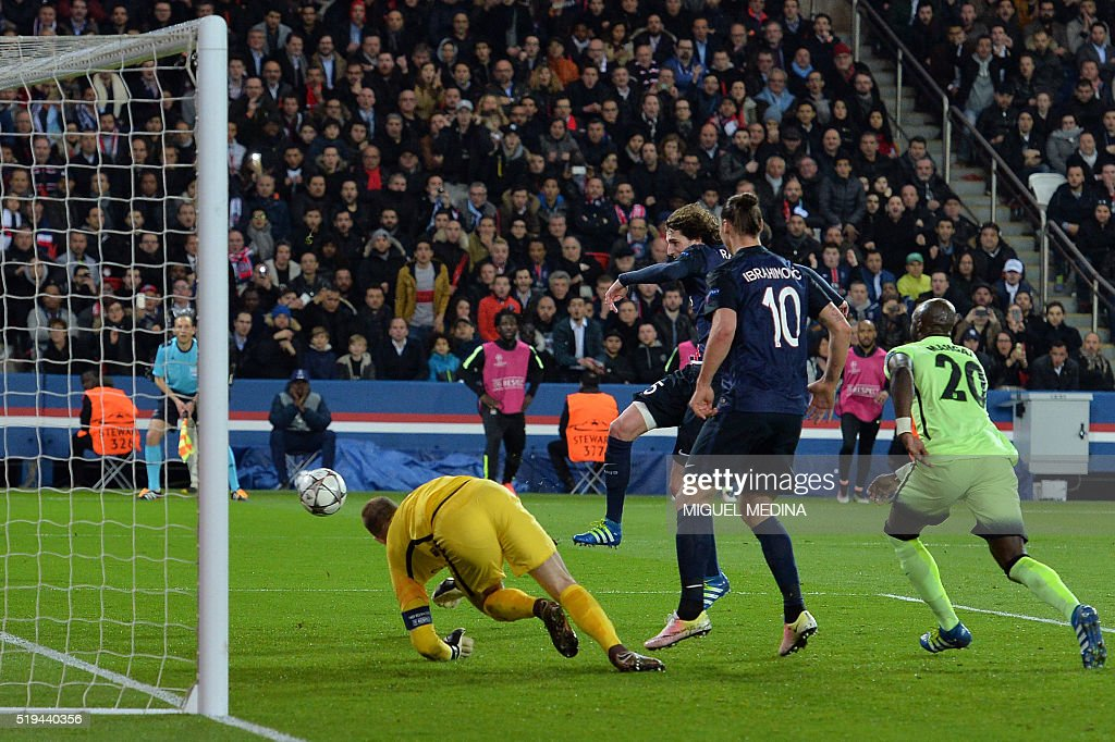 Paris Saint-Germain's French midfielder Adrien Rabiot (C) scores a goal during the UEFA Champions League quarter final football match between Paris Saint Germain (PSG) and Manchester City on April 6, 2016 at the Parc des Princes stadium in Paris.
