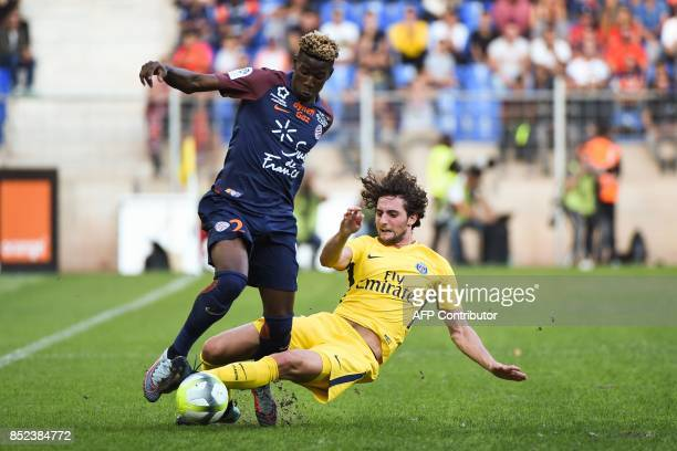 Paris SaintGermain's French midfielder Adrien Rabiot tackles Montpellier's French defender Nordi Mukiele during the French Ligue 1 football match...