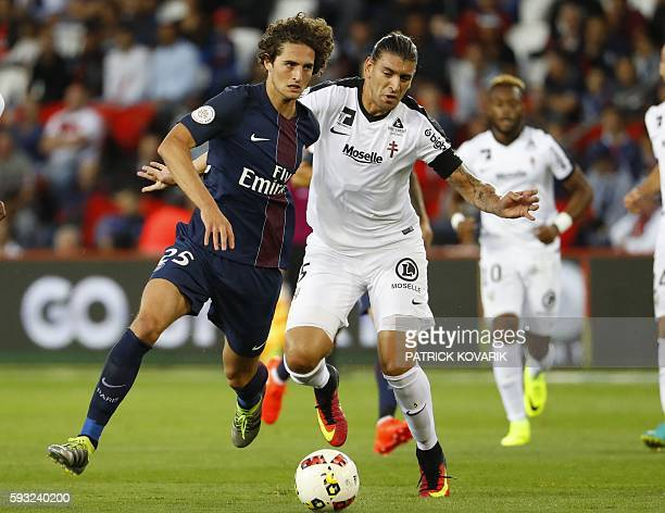 Paris SaintGermain's French midfielder Adrien Rabiot vies for the ball with Metz's Italian defender Guido Milan during the French L1 football match...