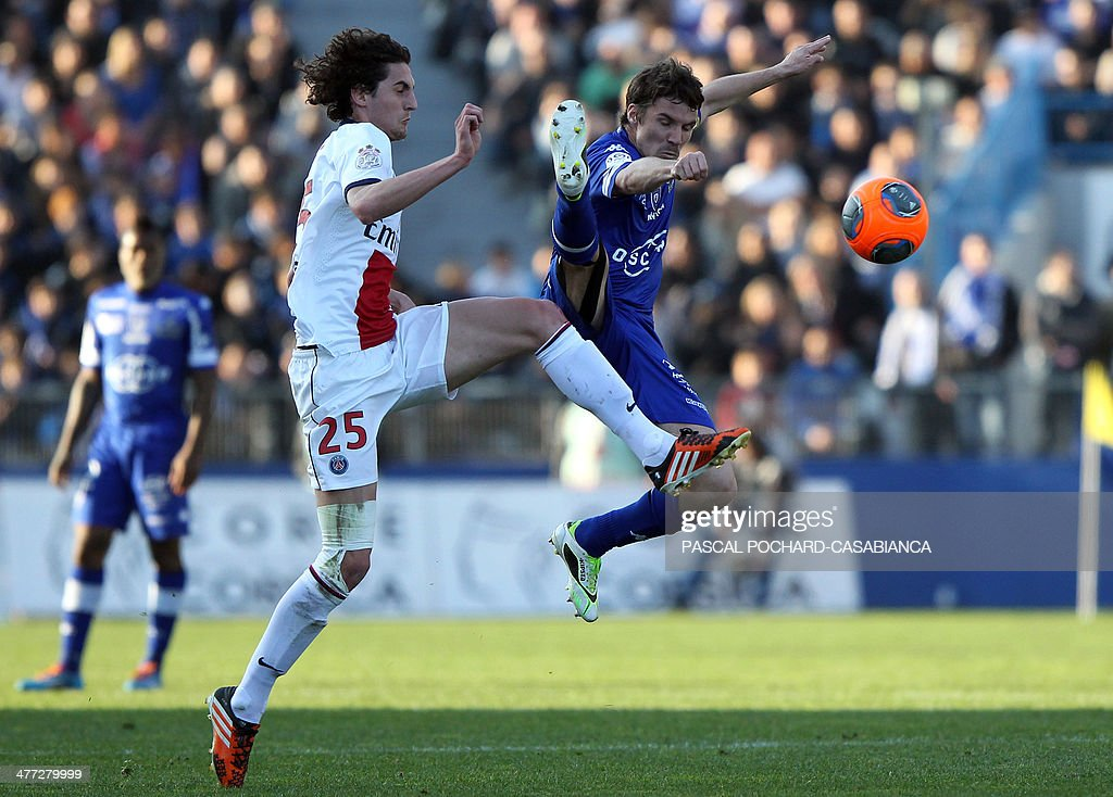 Paris Saint-Germain's French midfielder Adrien Rabiot (L) vies with Bastia's French midfielder Yannick Cahuzac during the French L1 football match between Bastia (SCB) and Paris Saint-Germain (PSG) at the Armand Cesari Stadium in Bastia, Corsica, on March 8, 2014. AFP PHOTO / PASCAL POCHARD-CASABIANCA