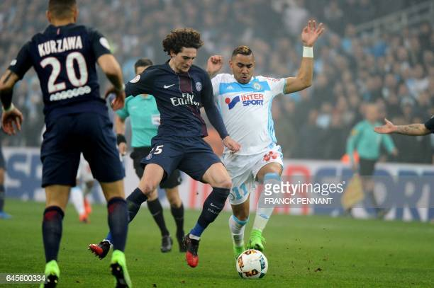 Paris SaintGermain's French midfielder Adrien Rabiot vies with Olympique de Marseille's French forward Dimitri Payet during the French L1 football...