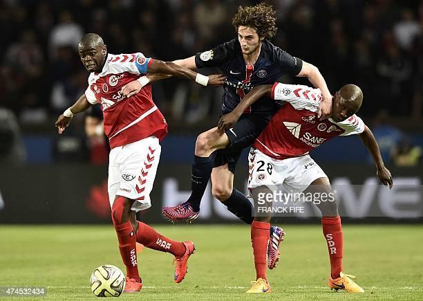 Paris SaintGermain's French midfielder Adrien Rabiot vies with Reim's forward David Ngog during the French L1 football match between Paris...
